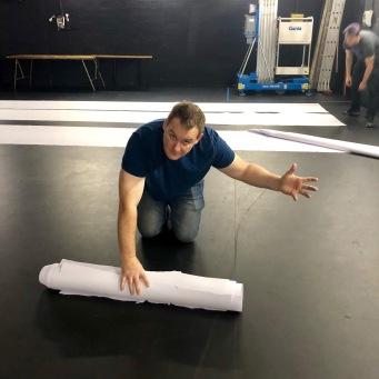 Zack rolls paper
